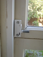 Window lock with one way screw